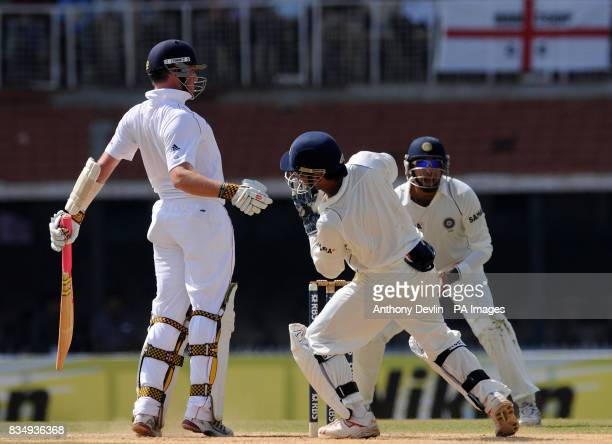 England's Graeme Swann is caught behind by India's Rahul Dravid bowled Harbhijan Singh for 1 during the second day of the First Test Match at the M A...