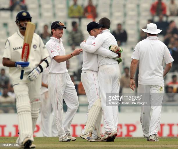 England's Graeme Swann is congratulated after Alastair Cook caught Gautam Gambhir for 179 during the second day of the second test at the Punjab...