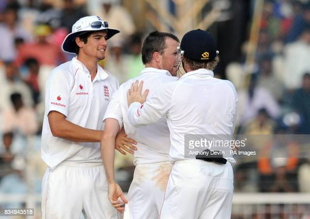 England's Graeme Swann is congratulated after taking the wicket of India's Virender Sehwag lbw for 83 during the fourth day of the First Test Match...