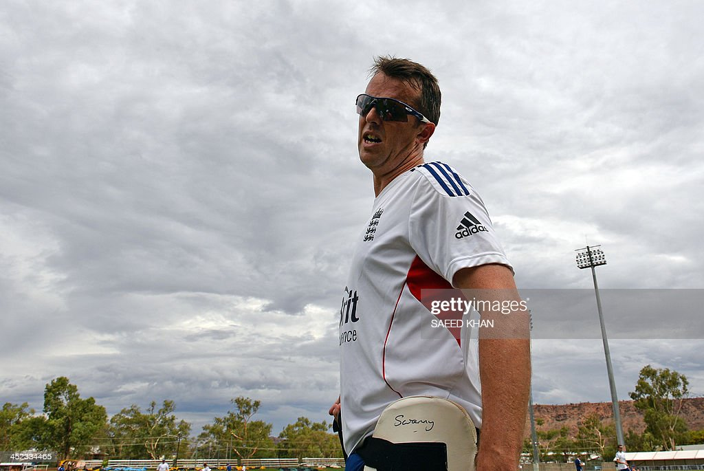 England's Graeme Swann talks to the media during a team training session at Traeger Park in Alice Springson November 28, 2013. England will play a two-day match against an Australian 'Chairman's XI' team on November 29 prior to their second Test match. AFP PHOTO / Saeed KHAN USE