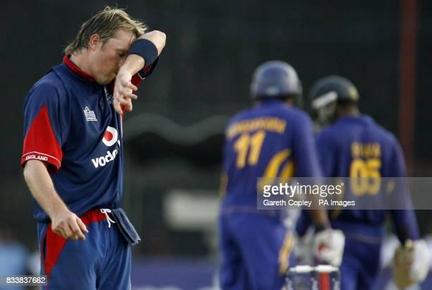England's Graeme Swann wipes his brow as Sri Lanka's Kumar Sangakkara and Chamara Silva build a strong total during the Fourth One Day International...