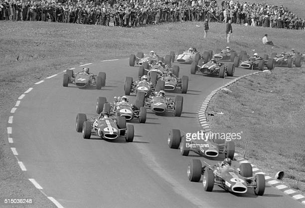 England's Graham Hill car no 6 gets off to a narrow lead in the early laps of the Grand Prix of the United States here October 1st Jim Clark of...