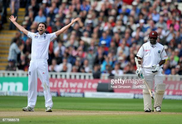 England's Graham Onions celebrates getting the West Indies's Narsingh Deonarine out caught by Andrew Strauss