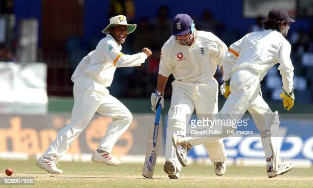 England's Graham Thorpe is stumped by Sri Lanka's Kumar Sangakkara for 19 runs as Hashan Tillakaratne celebrates during the fourth day of the third...