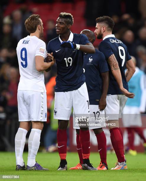 England's Harry Kane and France's Paul Pogba shake hands after the final whistle