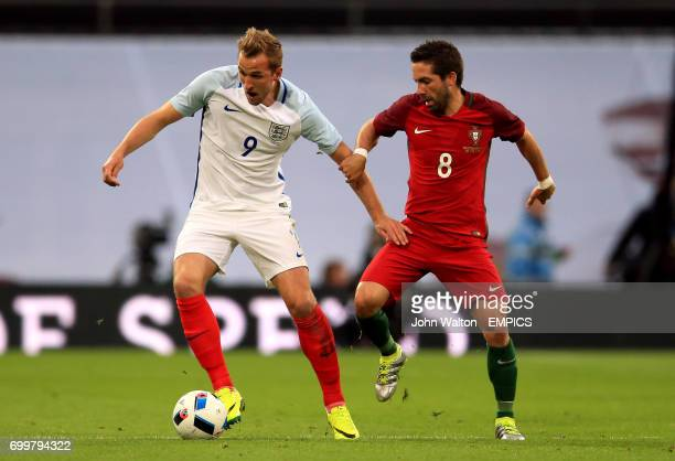 England's Harry Kane and Portugal's Joao Moutinho battle for the ball