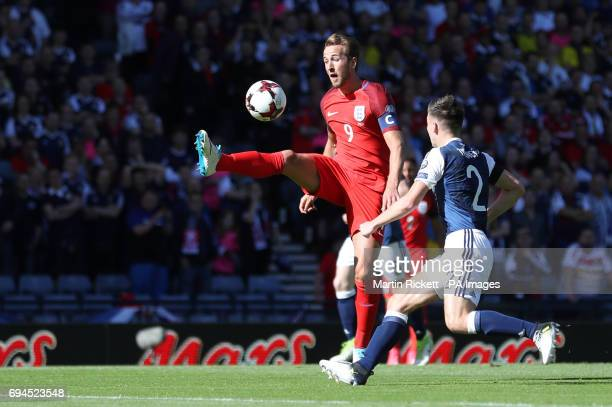 England's Harry Kane and Scotland's Kieran Tierney battle for the ball during the 2018 FIFA World Cup qualifying Group F match at Hampden Park Glasgow