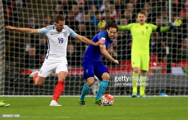 England's Harry Kane and The Netherlands' Daley Blind battle for the ball during the International Friendly match at Wembley Stadium London