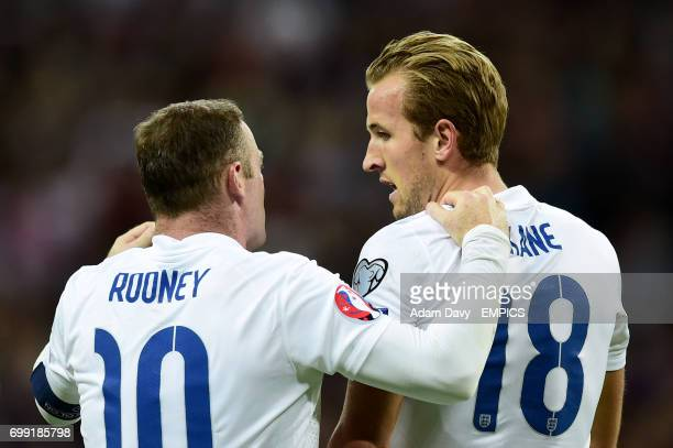 England's Harry Kane is congratulated on scoring their first goal of the game by teammate Wayne Rooney