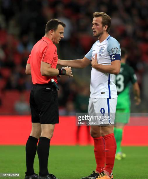 England's Harry Kane speaks with the match referee Felix Zwayer during the 2018 FIFA World Cup Qualifying Group F match at Wembley Stadium London