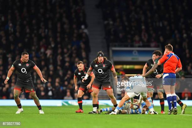 England's Harry Williams Danny Care and Ellis Genge patrol the base of the scrum during Old Mutual Wealth Series between England against Argentina at...