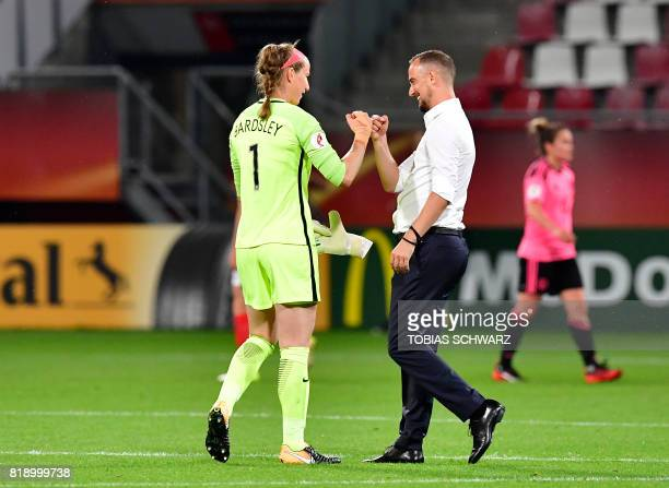 TOPSHOT England's head coach Mark Sampson congratulates England's goalkeeper Karen Bardsley after the UEFA Women's Euro 2017 football tournament...