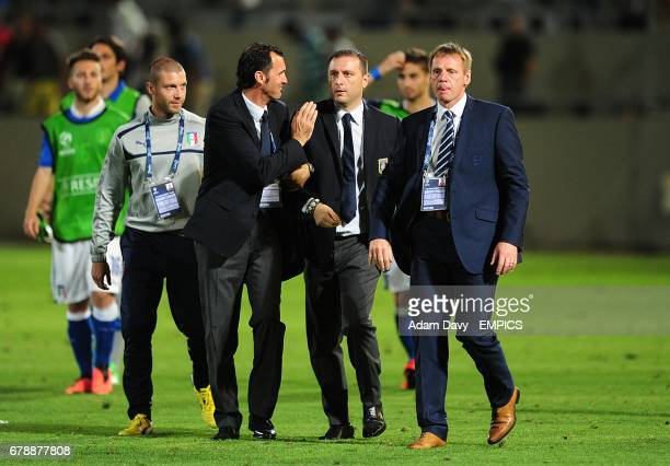 England's head coach Stuart Pearce walks off dejected after the game as Italy's coach Devis Mangia celebrates