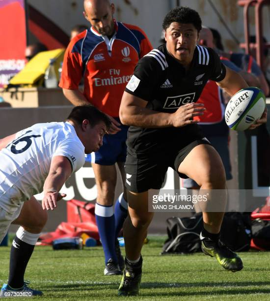 England's Henry Patrick Walker tackles New Zealand's Caleb Daniel Clarke during the 2017 World Rugby U20 Championship final match between England and...
