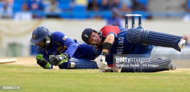 England's Ian Bell clashes with Sri Lanka's Kumar Sangakkara during the ICC Cricket World Cup match at the Sir Vivian Richards Stadium St Peter's...