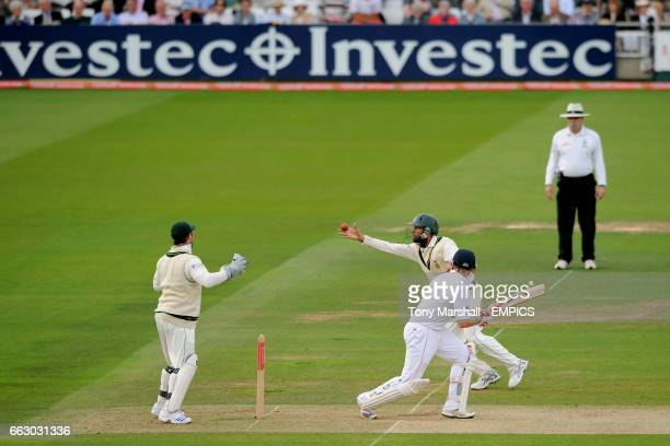 England's Ian Bell hit's the ball as South Africa's Hashim Amla goes for a catch