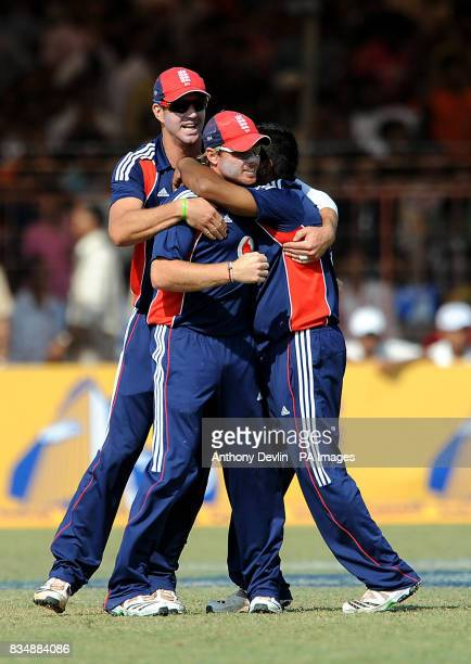 England's Ian Bell is congratulated by Samit Patel and Kevin Pietersen after catching India's Virender Sehwag during The First One Day International...