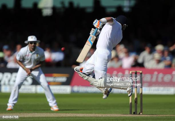 England's Ian Bell is hit by a short delivery from South Africa's Morne Morkel during the Third Investec Test Match at Lord's Cricket Ground London