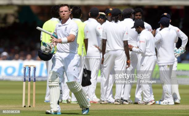 England's Ian Bell leaves the field after losing his wicket for 56 runs during day one of the Investec Test match at Lord's Cricket Ground London