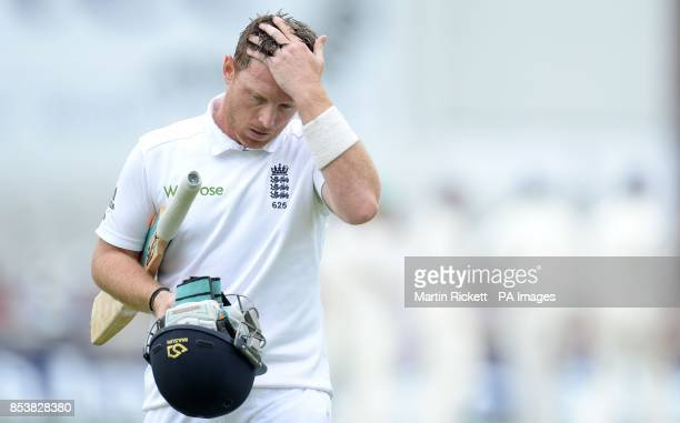 England's Ian Bell leaves the pitch after being caught out by India's Mahendra Dhoni from the bowling of Bhuvneshwar Kumar during the Fourth Investec...