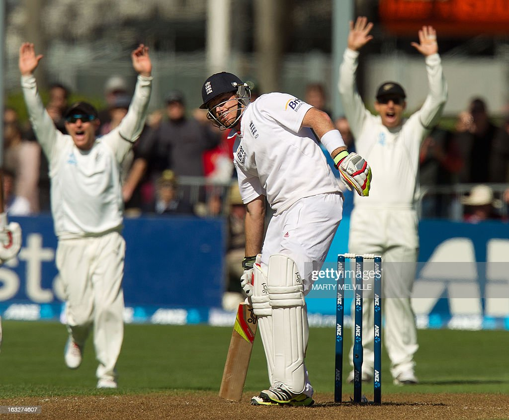 England's Ian Bell stays put as New Zealand's Brendon McCullum (L) and Ross Taylor (R) appeal to the Umpire during day two of the first international cricket Test match between New Zealand and England played at the University Oval park in Dunedin on March 7, 2013. AFP PHOTO / Marty MELVILLE