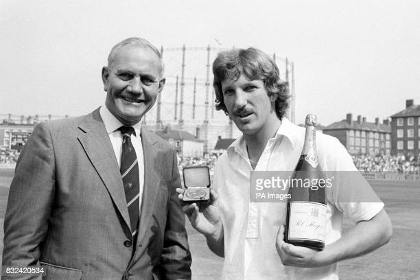 England's Ian Botham who completed the fastest test double of 1000 runs and 100 wickets on the first day's play is presented with a special Cornhill...