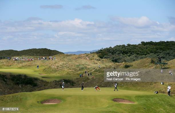 England's Ian Poulter and Belgium's Thomas Detry on the sixth green during day three of the Dubai Duty Free Irish Open at Portstewart Golf Club