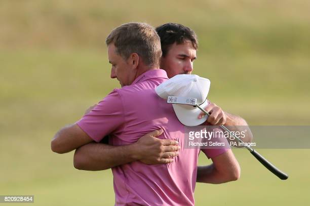 England's Ian Poulter and USA's Brooks Koepka embrace after the 18th during day three of The Open Championship 2017 at Royal Birkdale Golf Club...