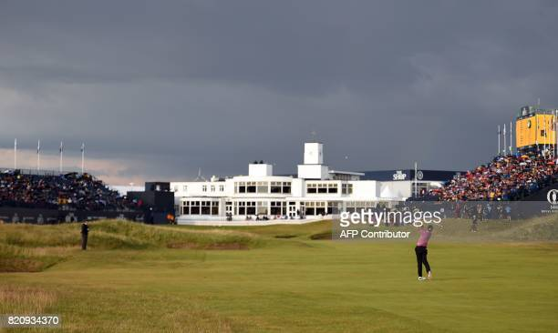 England's Ian Poulter plays from the fairway on the 18th hole towards the ArtDecostyle clubhouse during his third round on day three of the Open Golf...