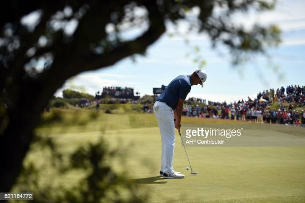 England's Ian Poulter putts on the 4th green during his final round on day four of the 2017 Open Golf Championship at Royal Birkdale golf course near...