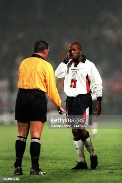 England's Ian Wright complains to the referee after being hit by Luxembourg's Jeff Saibene
