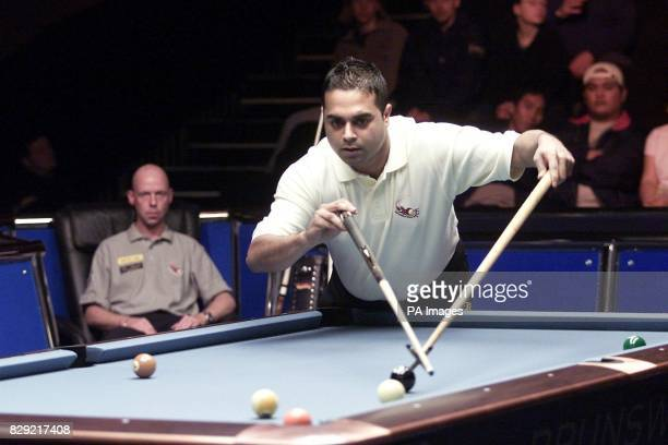 England's Imran Majid uses the rest during his first round match against Germany's Ralf Souquet in the 2002 World Pool Masters tournament in Woughton...