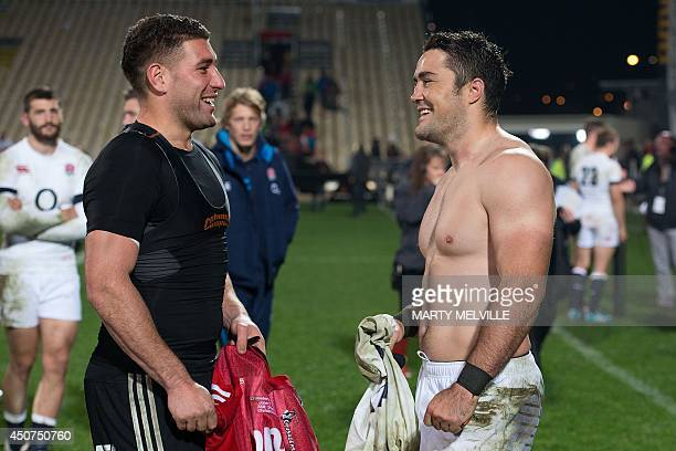 England's inside center Brad Barritt speaks with Canterbury Crusaders inside center Kieron Fonotia after their rugby union match at AMI Stadium in...