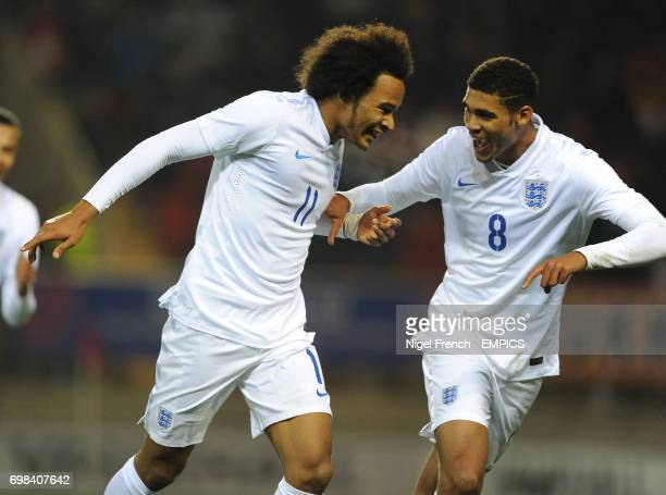 England's Isaiah Brown celebrates with Ruben LoftusCheek after scoring his sides second goal of the game against Italy