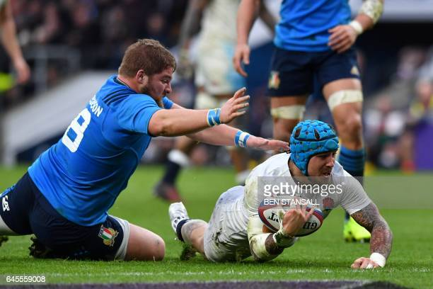 England's Jack Nowell dives over the line to score his second try during the Six Nations international rugby union match between England and Italy at...