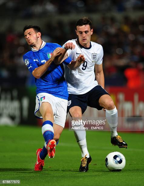 England's Jack Robinson and Italy's Alessandro Florenzi battle for the ball
