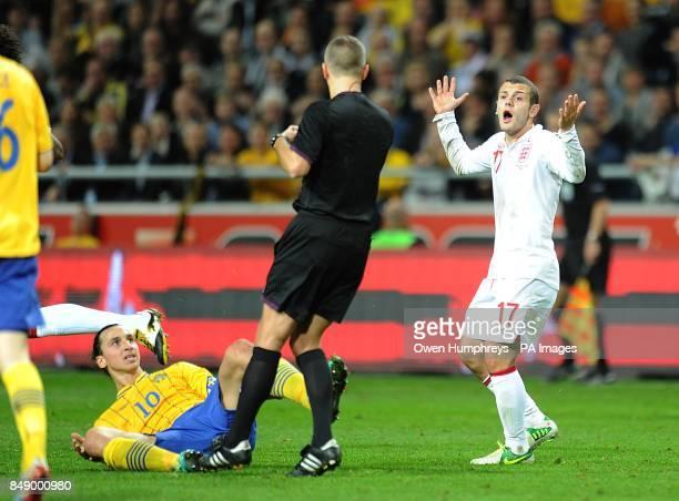England's Jack Wilshere appeals after a challenge on Sweden's Zlatan Ibrahimovic