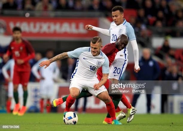 England's Jack Wilshere gets away from Portugal's Danilo Pereira as England's Dele Alli looks on