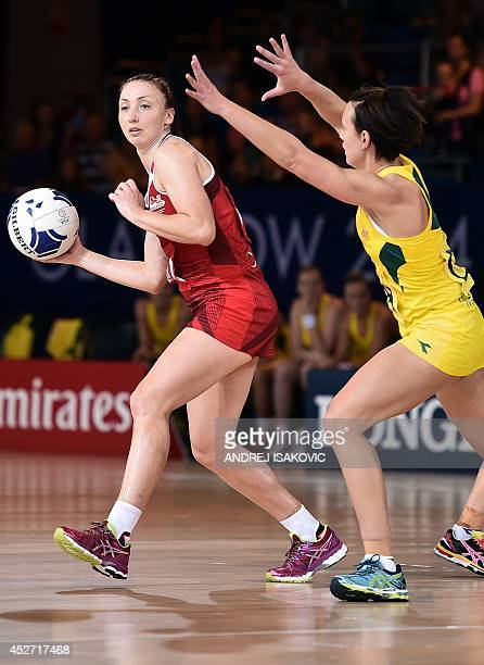 England's Jade Clarke vies with Australia's Tegan Caldwell during a Netball Group B Preliminary Round match between Australia and England at the 2014...