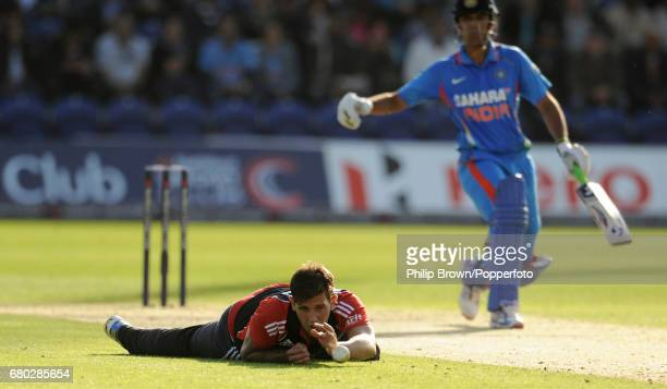 England's Jade Dernbach reacts after dropping a chance from the bat of India's Rahul Dravid during the fifth oneday international cricket match at...