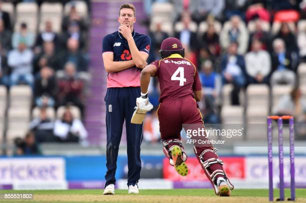 England's Jake Ball reacts as West Indies' Shai Hope runs between wicketsb during the final OneDay International cricket match between England and...