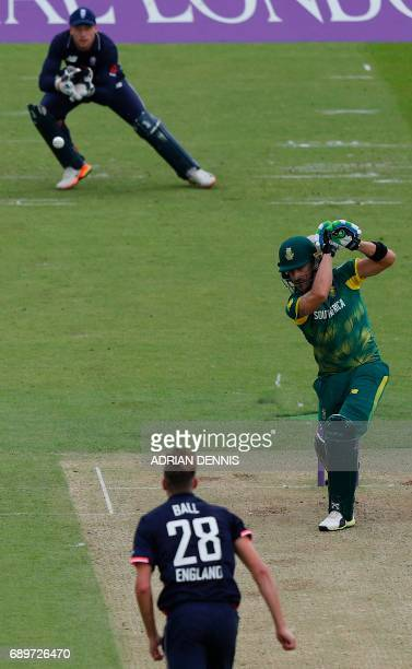 England's Jake Ball watches as England's Jos Buttler prepares to catch a shot from South Africa's Faf du Plessis to take his wicket for 5 runsduring...