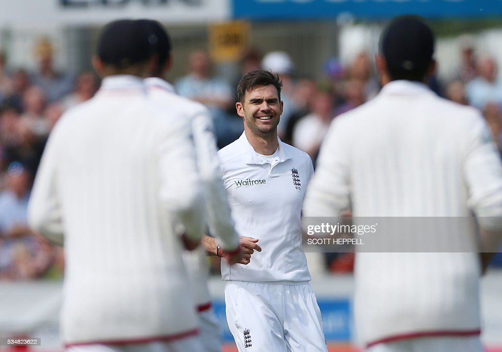 England's James Anderson (C) after bowling out Sri Lanka's Dimuth Karunaratne on the second day of the second test cricket match between England and Sri Lanka at the Riverside in Chester Le Street, north east England on May 28, 2016. / AFP / SCOTT