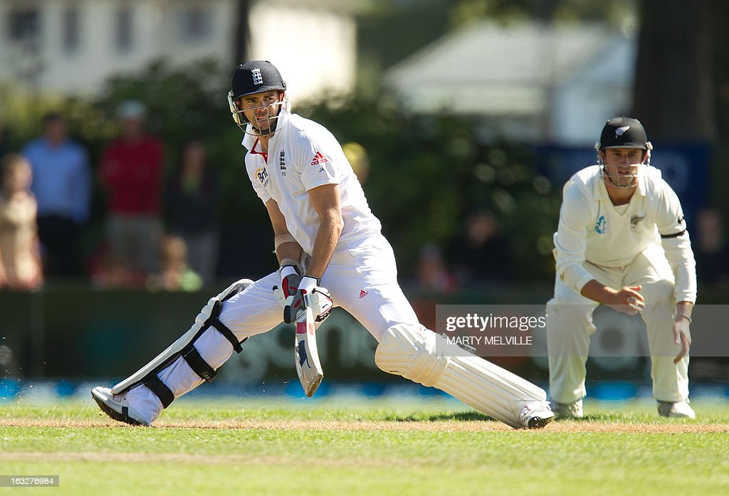 England's James Anderson bats with New Zealand's Hamish Rutherford fielding during day two of the first international cricket Test match between New Zealand and England played at the University Oval park in Dunedin on March 7, 2013. AFP PHOTO / Marty MELVILLE