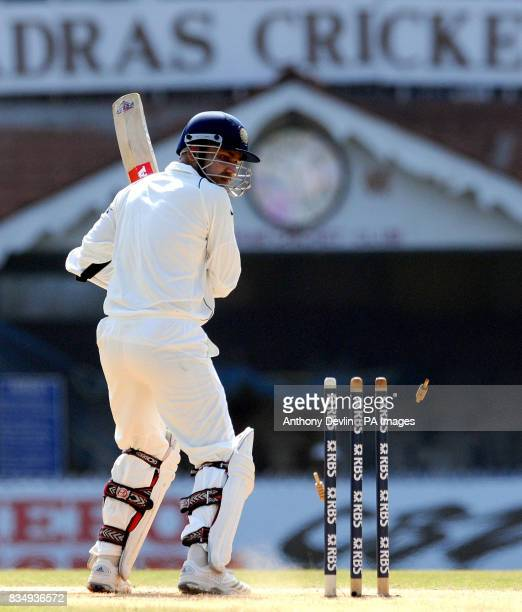England's James Anderson bowls out India's Virender Sehwag for 9 during the second day of the First Test Match at the M A Chidambaram Stadium in...