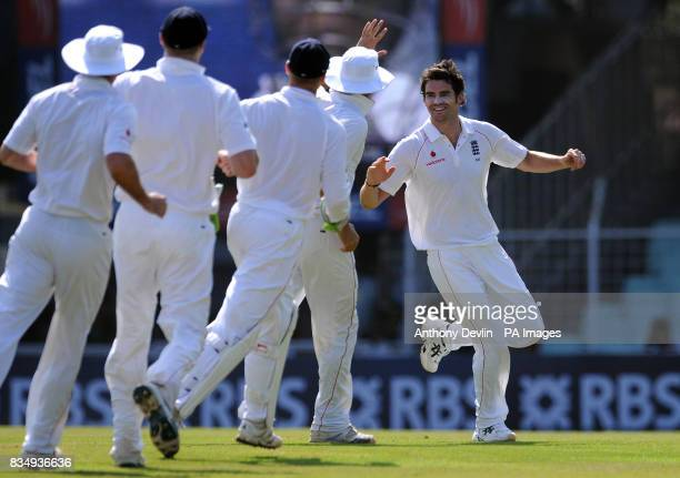 England's James Anderson celebrates after bowling out India's Virender Sehwag for 9 during the second day of the First Test Match at the M A...