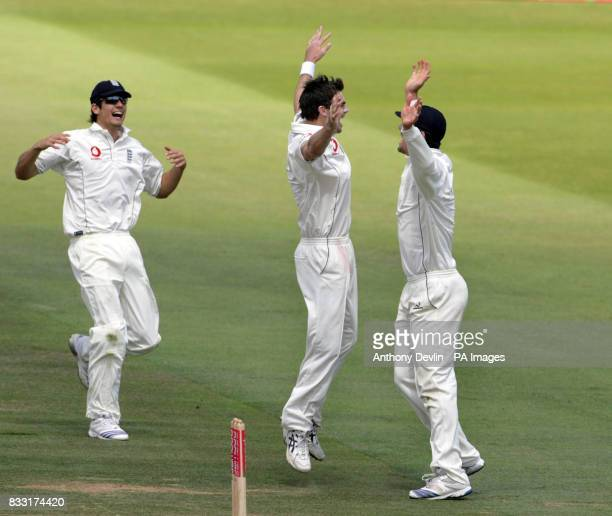 England's James Anderson celebrates after taking the wicket of India's Mahendra Singh Dhoni caught by Ian Bell for 0 during the third day of the...