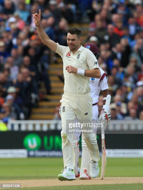 England's James Anderson celebrates after taking the wicket of West Indies' Kieran Powell during play on day 3 of the first Test cricket match...