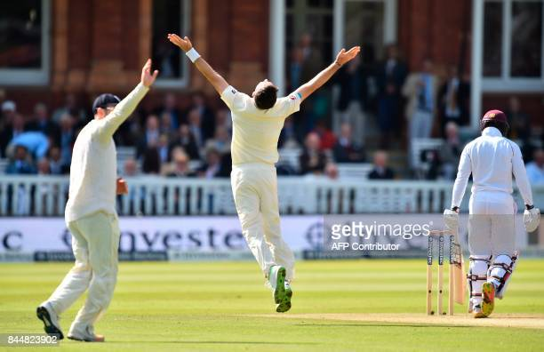 England's James Anderson celebrates after taking the wicket of West Indies' Shai Hope during the third day of the third international Test match...