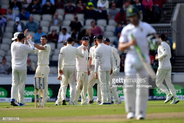 England's James Anderson celebrates as South Africa's Faf du Plessis is caught behind for 61 runs during day four of the Fourth Investec Test at...